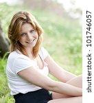 blond girl at summer park.   Shutterstock . vector #101746057