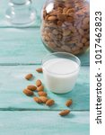 almond milk on wooden table   Shutterstock . vector #1017462823
