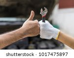 mechanic hand checking and...   Shutterstock . vector #1017475897