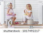 two little girls play in the...   Shutterstock . vector #1017492217
