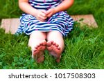 close up of child feet of... | Shutterstock . vector #1017508303