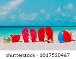 colored flip flops  toys and... | Shutterstock . vector #1017530467