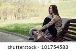 Beautiful Girl Sitting On The...