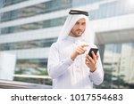 businessman arabic using mobile ... | Shutterstock . vector #1017554683