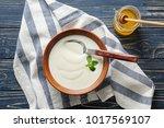 tasty yogurt in dish and jar of ...   Shutterstock . vector #1017569107