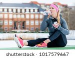 woman resting from jogging or... | Shutterstock . vector #1017579667