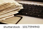 newspapers and laptop. pile of... | Shutterstock . vector #1017594943