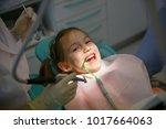 little girl at dentist office ...   Shutterstock . vector #1017664063