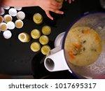 a cook blends porridge with... | Shutterstock . vector #1017695317