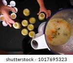 a cook blends porridge with... | Shutterstock . vector #1017695323