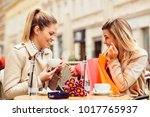 two women after shopping in cafe | Shutterstock . vector #1017765937
