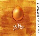 golden easter egg with lettered ... | Shutterstock .eps vector #1017770017