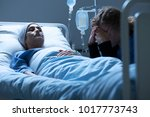 crying friend and weak woman... | Shutterstock . vector #1017773743