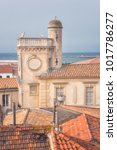 Small photo of Saintes-Maries-de-la-Mer, top view of town tiled roofs, building of ancient Town Hall and seaside from fortified church Notre-Dame-de-la-Mer, mediterranean resort in Camargue, Provence, France