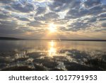 sunrise on the sea with the... | Shutterstock . vector #1017791953