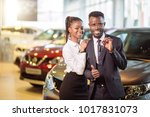 young african couple with car... | Shutterstock . vector #1017831073