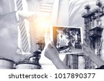 engineer hand using tablet with ... | Shutterstock . vector #1017890377
