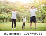 happy asian family with their... | Shutterstock . vector #1017949783