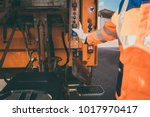garbage removal worker emptying ... | Shutterstock . vector #1017970417