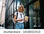 female tourist using...   Shutterstock . vector #1018021513