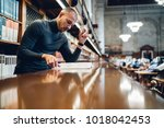 concentrated male journalist... | Shutterstock . vector #1018042453