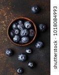fresh ripe blueberries with... | Shutterstock . vector #1018084993