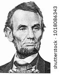 Small photo of abraham lincoln's portrait on front of a five dollar bill.