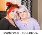 mother and daughter in kitchen...   Shutterstock . vector #1018100257