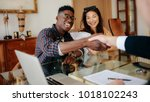 happy property owners shaking... | Shutterstock . vector #1018102243