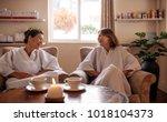 female friends sitting in... | Shutterstock . vector #1018104373