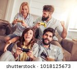 excited friends playing video... | Shutterstock . vector #1018125673