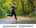 woman running in the autumn park | Shutterstock . vector #1018143547