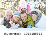family in winter park | Shutterstock . vector #1018185913