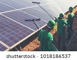 labor working on cleaning solar ... | Shutterstock . vector #1018186537