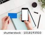 man using smartphone to... | Shutterstock . vector #1018193503