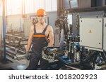 worker at the window factory | Shutterstock . vector #1018202923