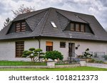 house in the small city in... | Shutterstock . vector #1018212373