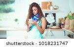 pretty woman drinking some wine ... | Shutterstock . vector #1018231747