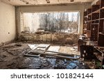 Water pouring down on wall in abandoned room in pripyat - stock photo