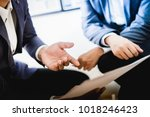 business partners discussing... | Shutterstock . vector #1018246423