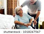 senior couple taking care of... | Shutterstock . vector #1018267567