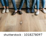 pairs of legs with wooden floor | Shutterstock . vector #1018278097