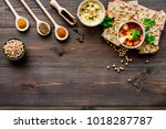 serve hummus. bowl with dish...   Shutterstock . vector #1018287787