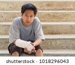 asian boy with broken arm to... | Shutterstock . vector #1018296043