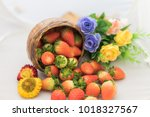strawberries and flowers on a...   Shutterstock . vector #1018327567