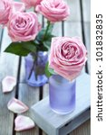 Arrangement with pink roses on a wooden background - stock photo