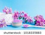 spa sea salt  towel and flower... | Shutterstock . vector #1018335883