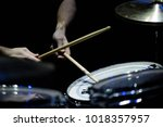 the drummer in action. a photo... | Shutterstock . vector #1018357957