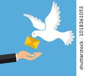 the mail pigeon brings a letter.... | Shutterstock .eps vector #1018361053