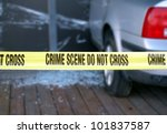 Yellow tape is put up to mark a crime scene - stock photo